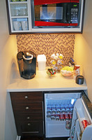 Wet bar with fridge, microwave, and coffee maker