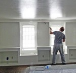 Ron painting ceiling in living room