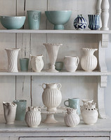 Shelves with vases in white and pastel colors