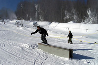 Snowboarder on an obstacle